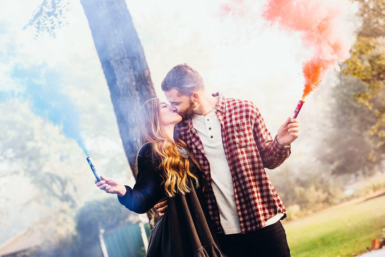 couple playing with smoke bombs