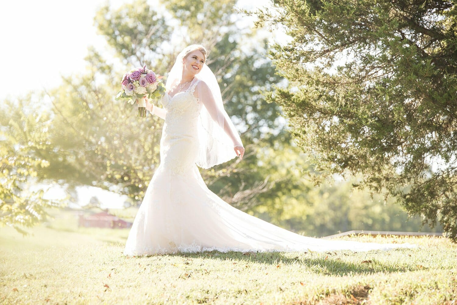 bride in field at Sassafras Springs Vineyard