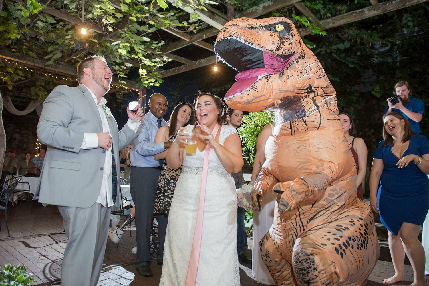 wedding couple laughing at dinosaur custom