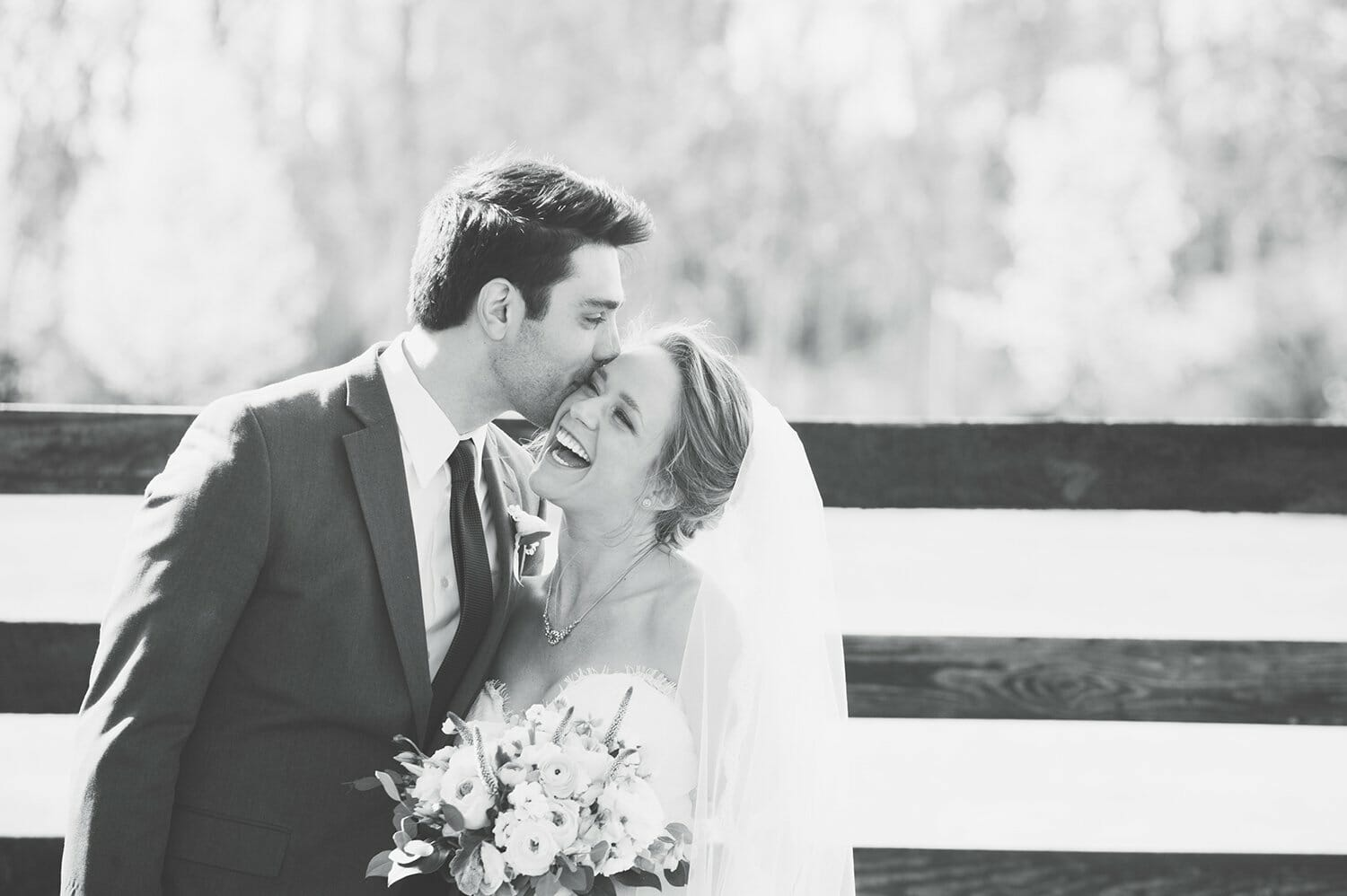 black and white photo of couple laughing together