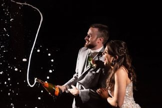 popping champagne wedding celebration northwest arkansas wedding photographer striegler photo