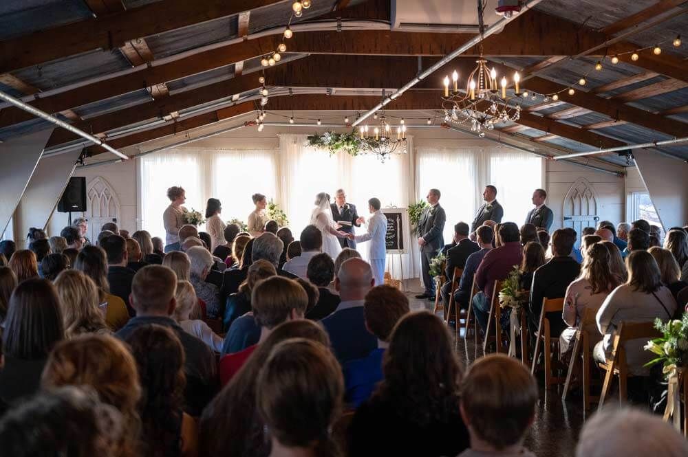 indoor wedding ceremony at the Barn at the Springs
