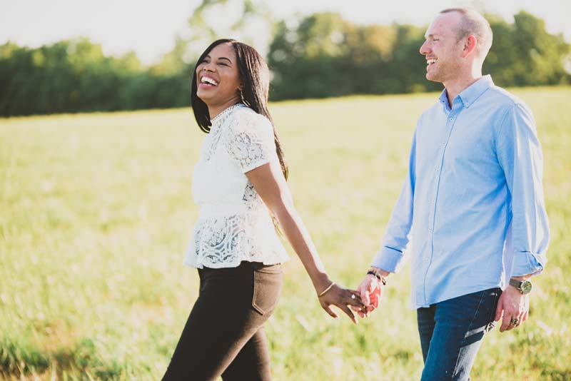 couple walking and laughing