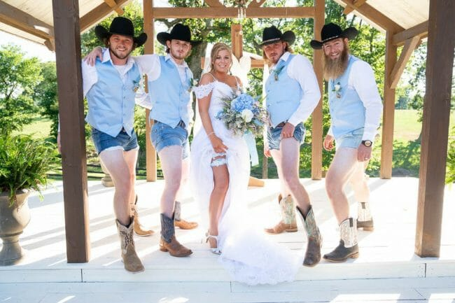 bride and groomsmen showing off legs