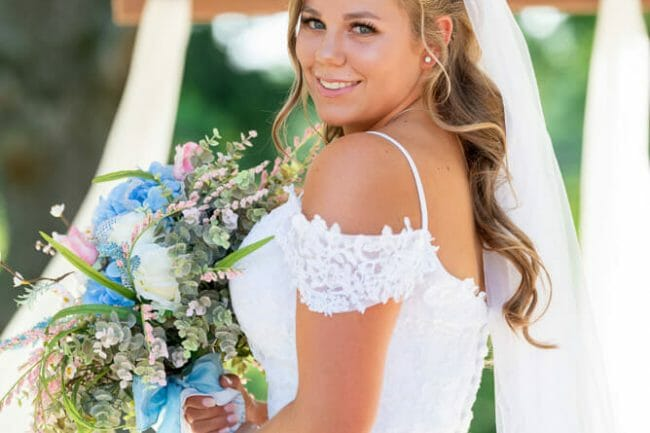 bride outside at Barn at the Springs