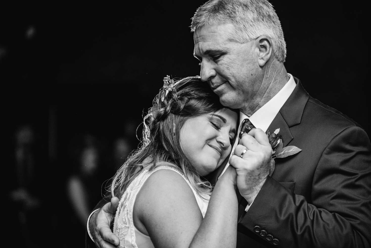 bride hugging father during dance