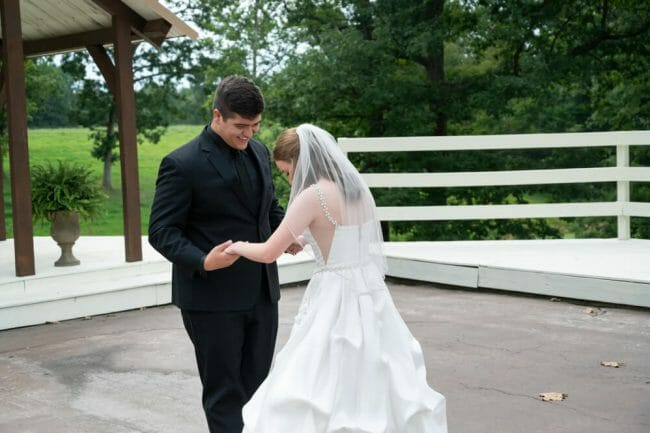 groom seeing bride at Barn at the Springs