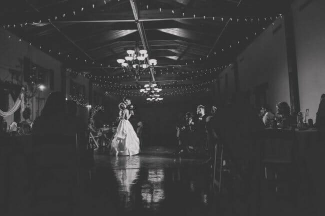 black and white first dance photo with dramatic lighting