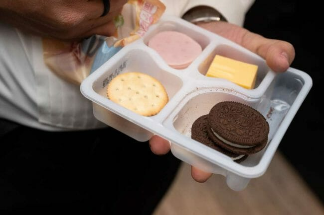 groom eating a Lunchable