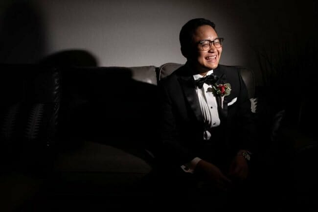 groom portrait at New Year's Eve wedding