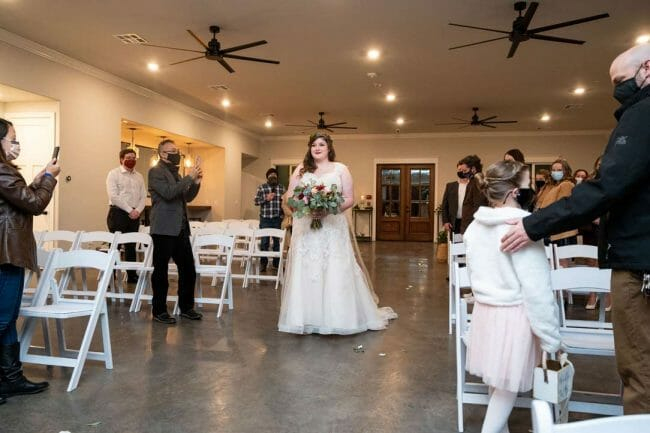 bride coming down the aisle at White River Landing