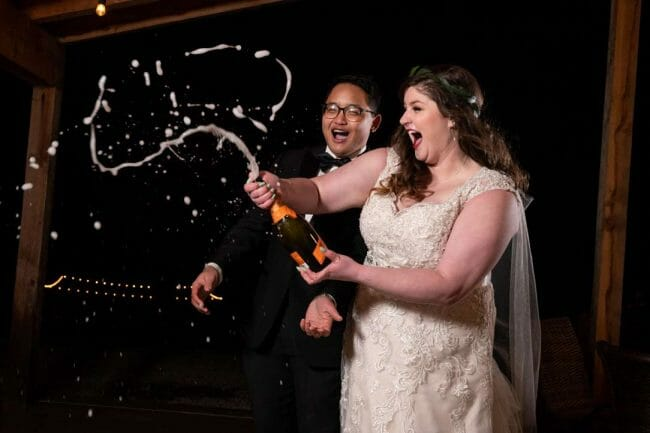 shooting champagne at New Year's Eve wedding