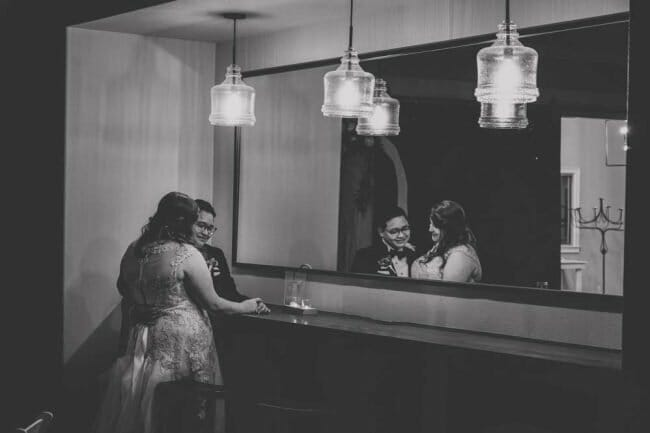 black and white wedding photo with mirrors and light