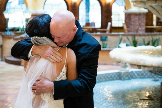 dad hugging bride after first look