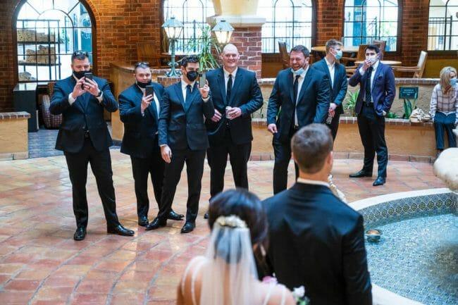 groomsmen watching first look