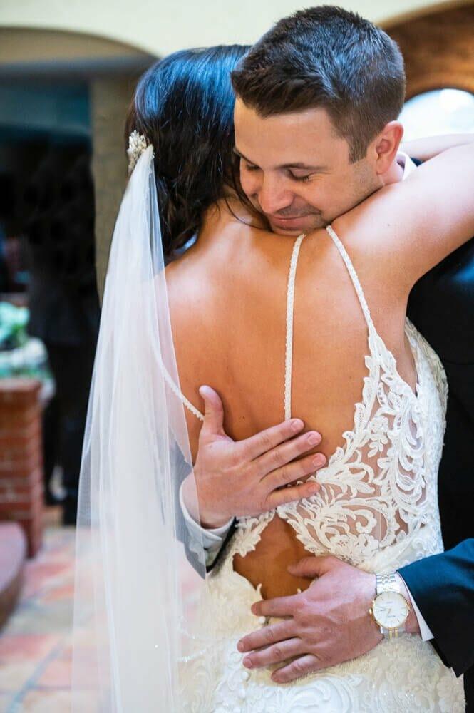 groom hugging bride after first look