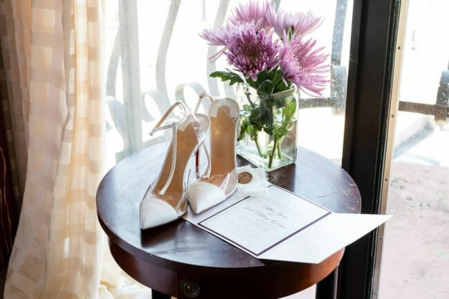 flowers and shoes on table
