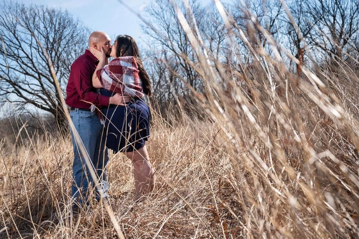 engagement photos in high grass at Burr Oak Woods