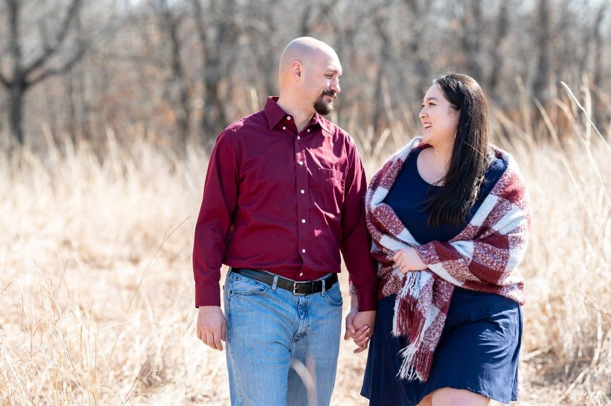 couple walking through fields at Burr Oak Woods