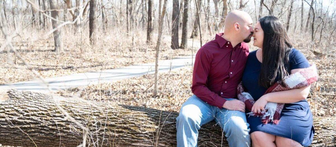 couple sitting on fallen log