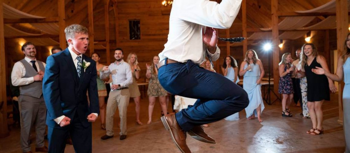 wedding guest dancing and jumping